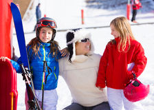 Snow winter family in ski track mother and daughters. Smiling happy with equipment Royalty Free Stock Photo