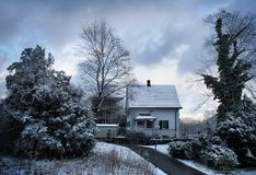 Snow Winter House. Winter sunny street and house Stock Images
