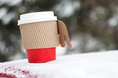 Snow winter papper coffee cup and holiday. Coffee in papper cup with snow winter and holiday Royalty Free Stock Photo