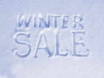 Snow Winter Sale. Winter Sale written on glittering snow, New Year's background Royalty Free Stock Photos