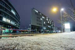Snow in winter on a sidewalk und blurred car lights Royalty Free Stock Photography