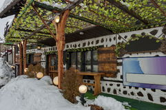Snow winter street  in the Bansko town with ancient houses and vine Stock Images