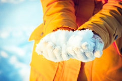 Snow in Woman Hands giving Winter Lifestyle Stock Photos