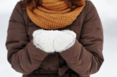 Snow in woman hands Stock Photo