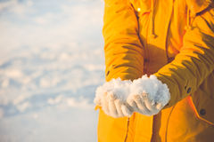 Snow in Woman Hands Winter season Lifestyle. Vacations Outdoor Royalty Free Stock Image