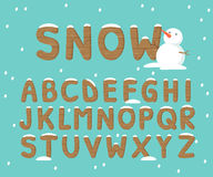 Snow and wood alphabet Royalty Free Stock Images