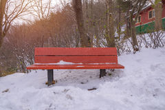 Snow on wood bench in park of winter Stock Photo