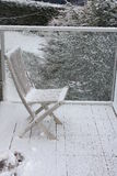 Snow on wooden chair Stock Photo