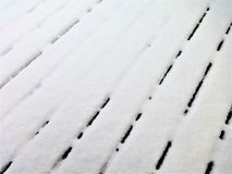 Snow on a wooden deck Royalty Free Stock Image