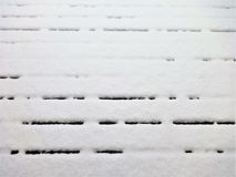 Snow on a wooden deck Stock Images