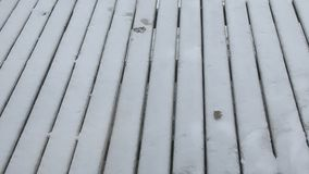 Snow on a wooden deck Royalty Free Stock Photos