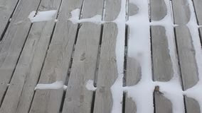 Snow on a wooden deck during winter Stock Photo