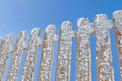 Snow on the wooden fence Stock Images
