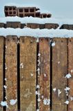 Snow on Wooden Palettes. Wooden palettes covered with snow in winter Royalty Free Stock Photo