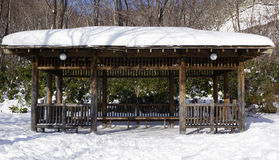 Snow and wooden pavilion elevation in the forest Noboribetsu ons Royalty Free Stock Image