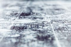 Snow on a wooden surface stock image