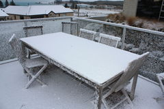 Snow on wooden table and chairs Royalty Free Stock Images