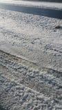 Snow world. Snowy ground tracks Royalty Free Stock Photos