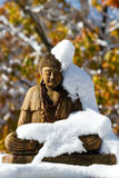 Snow wrapped Buddha statue Royalty Free Stock Image