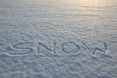 Snow Writing Word Stock Image