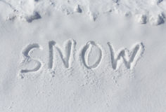 SNOW written in snow Stock Image