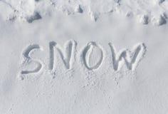 SNOW written in snow Stock Image