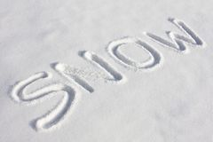 SNOW Written In A Snowy Field Stock Photos