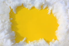 Snow on a yellow background. Framework of snow. Form for inscription Stock Photos