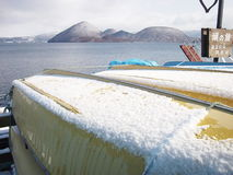 Snow on yellow fishery boat Royalty Free Stock Photo