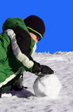 Snowball. A boy making a snowball Royalty Free Stock Photography