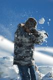 Snowball. Direct hit in a snowball fight stock images