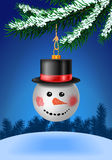Snowball bauble in black hat on christmas tree Stock Image