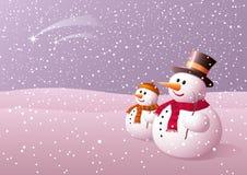 Snowball e seu filho que olha nas estrelas de queda. Fotos de Stock Royalty Free
