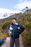 Snowball fight!. A man wincing as a child throws a snowball at him. Photo taken at Cradle Mountain in Tasmania Royalty Free Stock Photography