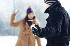 Snowball fight!. Winter collection: snowball fight between young couple Royalty Free Stock Photos