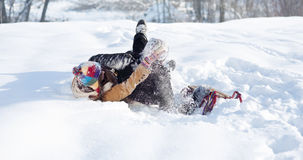 Snowball fight!. Winter collection: young couple playing with snow Royalty Free Stock Images
