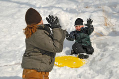 Snowball Fight. Children having a snowball fight in winter snow stock photography