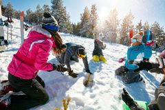 Snowball fight with friends Royalty Free Stock Image