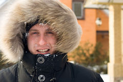 After snowball fight - man in warm jacket Stock Images