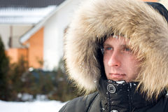 Snowball fight - man in warm jacket Royalty Free Stock Photo