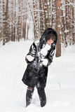 Snowball fight. Winter couple having fun playing in snow outdoors. stock images