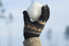 Snowball in hand Stock Image