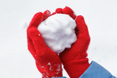 Snowball in hands Royalty Free Stock Image