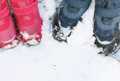 Children`s winter boots in the sno royalty free stock photos