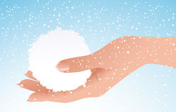 Snowball in human hand Royalty Free Stock Images