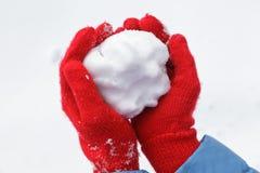Snowball nas mãos Imagem de Stock Royalty Free