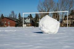 Snowball ready for penalty kick Royalty Free Stock Photos