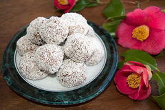 Snowball truffles of chocolate and coconut topping stock photos