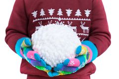Snowball of white threads in child`s hands, clad in colorful gloves isolated on white background, New Year, Christmas. Snowball of white threads in child`s hands stock photo
