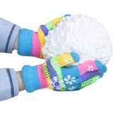Snowball of white threads in child`s hands, clad in colorful gloves isolated on white background, New Year, Christmas. Snowball of white threads in child`s hands stock image